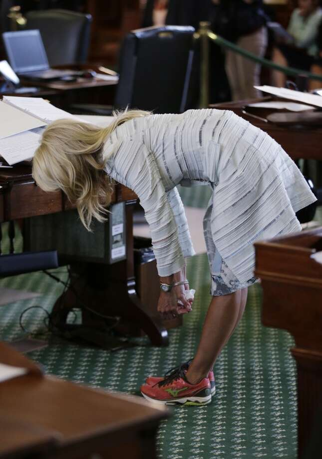 Davis stretches during her filibuster June 25, 2013, in Austin. Photo: Eric Gay, Associated Press
