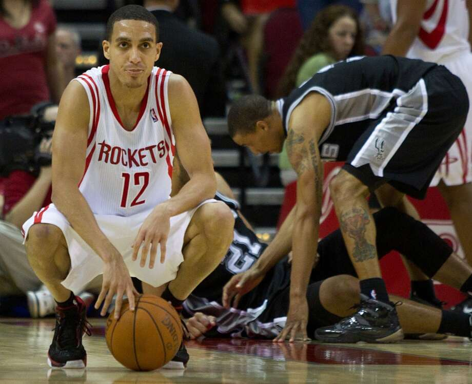 Rockets shooting guard Kevin Martin reacts after a fouls against Spurs center Tim Duncan during the final minutes of the fourth quarter of a Spurs 115-107 victory on March 12, 2011, in Houston. Photo: Smiley N. Pool, Houston Chronicle