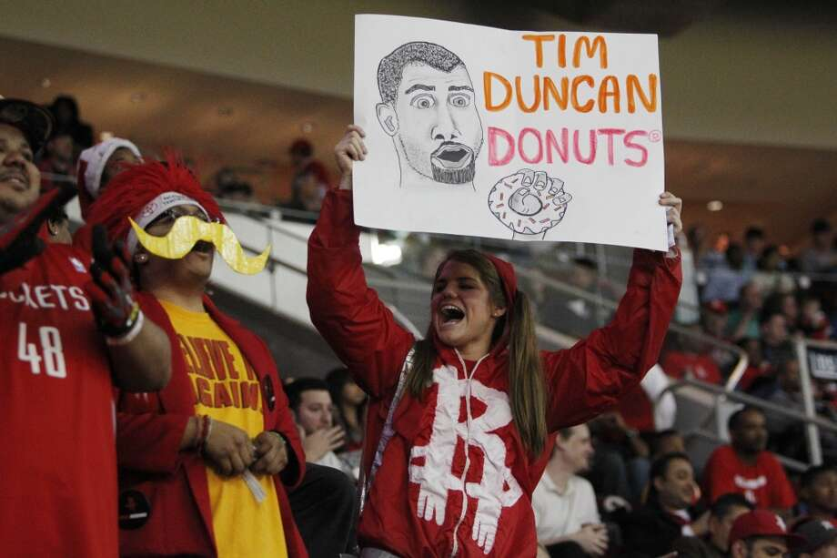A Rockets fan holds up a sign mocking Tim Duncan's name. Photo: Houston Chronicle
