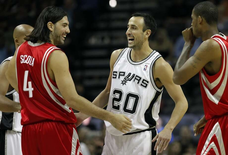 Spurs' Manu Ginobili shares a laugh with fellow Argentinian and Rocket Luis Scola before an October 6, 2009 preseason. The Rockets acquired Scola in a trade with the Spurs. Scola played for the Rockets from 2007 to 2012. Photo: Kin Man Hui, San Antonio Express-News