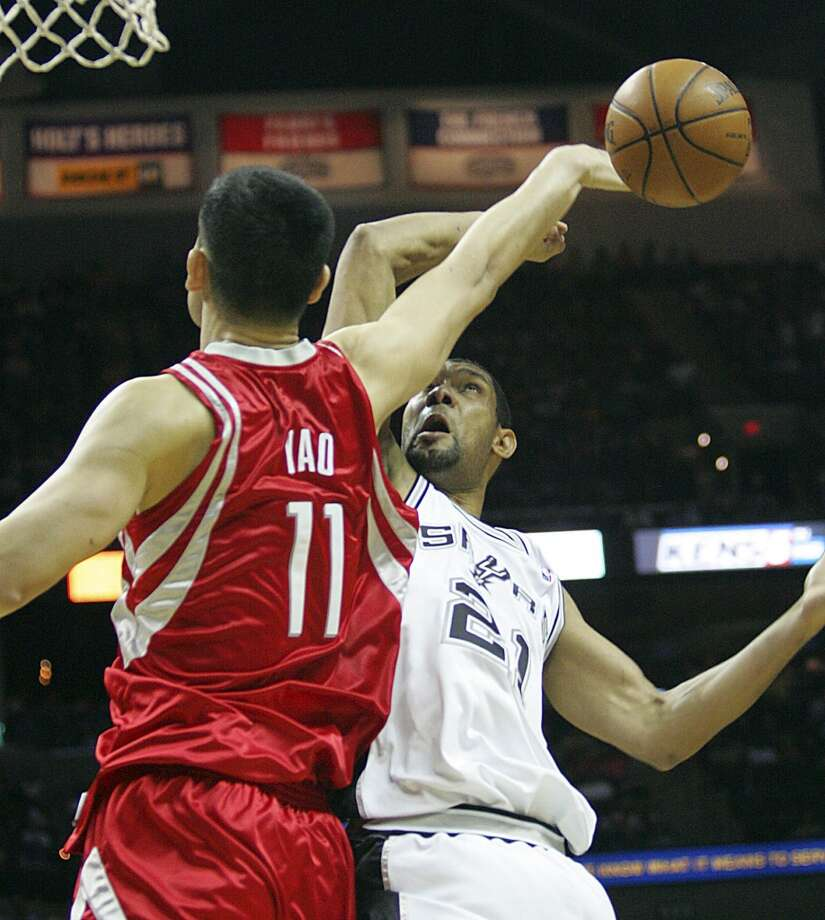 Yao Ming blocks a shot by Tim Duncan in this March 22, 2009 photo. Photo: Delcia Lopez, Associated Press