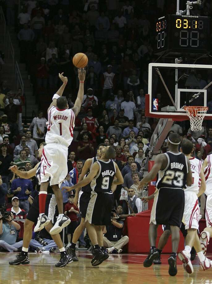 Tracy McGrady scores 13 points in 35 seconds, including the game-winning three-pointer with 1.7 seconds left as the Rockets rally to beat the Spurs 81-80 on Dec. 9, 2004. Photo: James Nielsen, Houston Chronicle