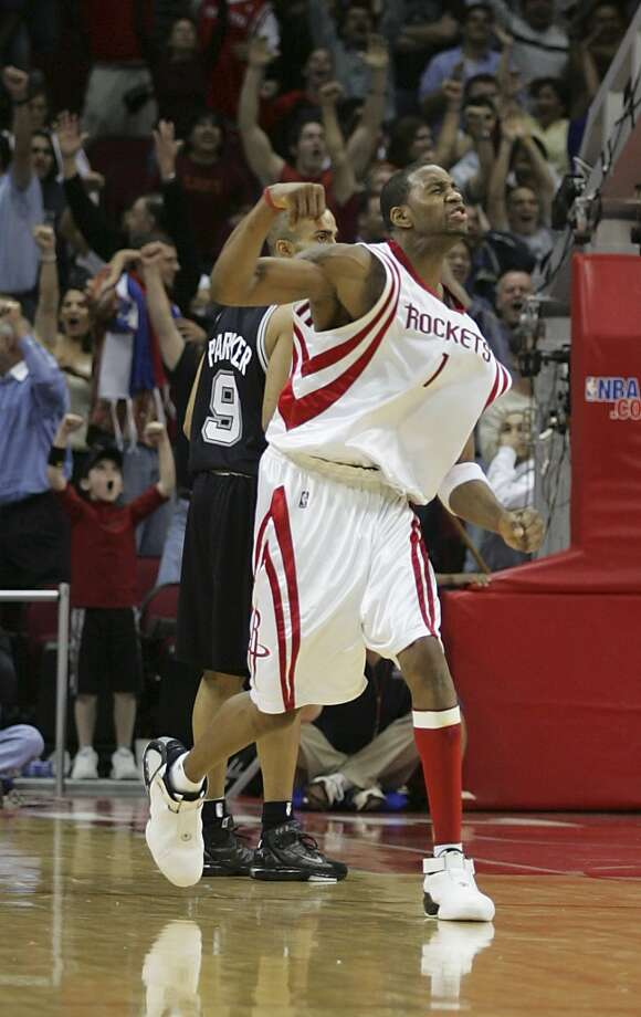 Tracy McGrady reacts after hitting the game-winning shot. Photo: James Nielsen, Houston Chronicle