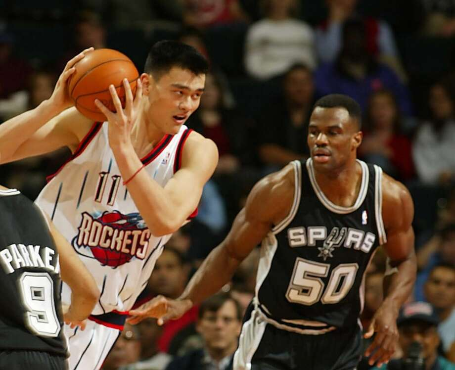 Yao Ming faces off against David Robinson in this March 2, 2003 photo. Photo: James Nielsen, Houston Chronicle