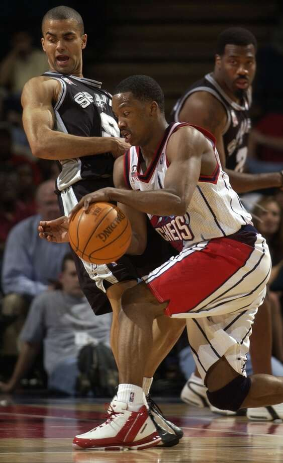 Spurs guard Tony Parker falls backwards as he collides with Rockets guard Steve Francis in this April 4, 2002 photo. Photo: Smiley N. Pool, Houston Chronicle