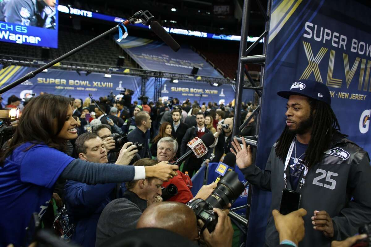 Richard Sherman speaks to Entertainment Tonight reporter Rocsi Diaz during Super Bowl Media Day on Tuesday, January, 28, 2014 at the Prudential Center in Newark, NJ. During Media Day players are available for for interviews and photos. (Joshua Trujillo, seattlepi.com)