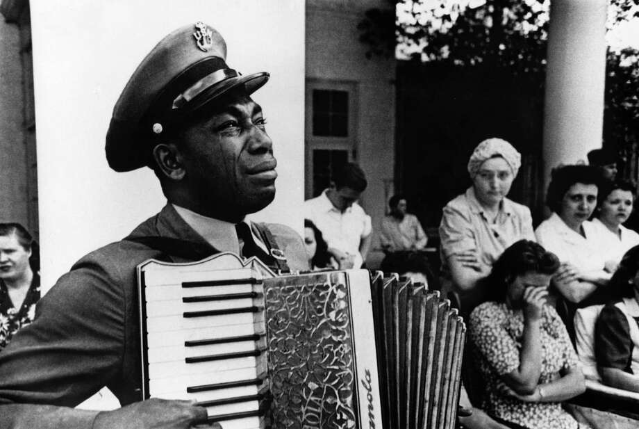 "Embodying the grief of a nation, celebrated organist and Navy officer Graham Jackson sorrowfully played ""Goin' Home"" for the late President Franklin Roosevelt in Warm Springs, Ga. in 1945. The image, taken by famed photojournalist Ed Clark, is on view in ""Ed Clark: American Photojournalist"" at the Bruce Museum in Greenwich through June 1. Photo: Ed Clark, Contributed Photo / Connecticut Post Contributed"