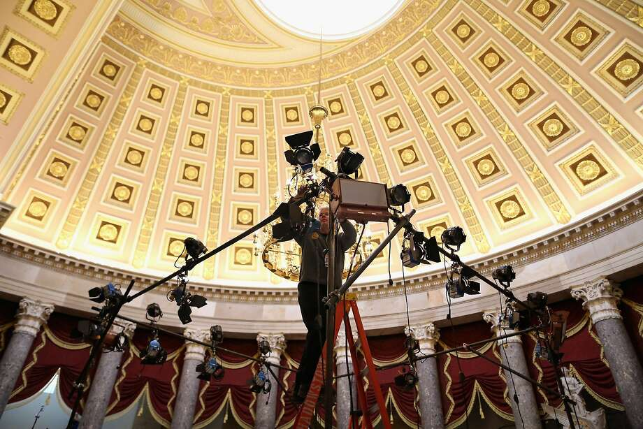 Before the president's State of the Union address, TV lighting technicians build sets inside the Capitol's Statuary Hall. Photo: Chip Somodevilla, Getty Images