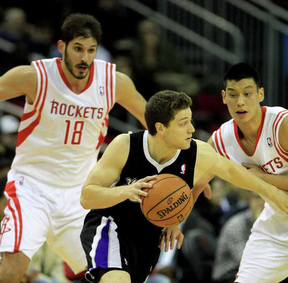 Houston Rockets forward Omri Casspi (18) and Jeremy Lin guard Sacramento Kings point guard Jimmer Fredette at the Toyota Center last week. Photo: Karen Warren, Staff / © 2013 Houston Chronicle