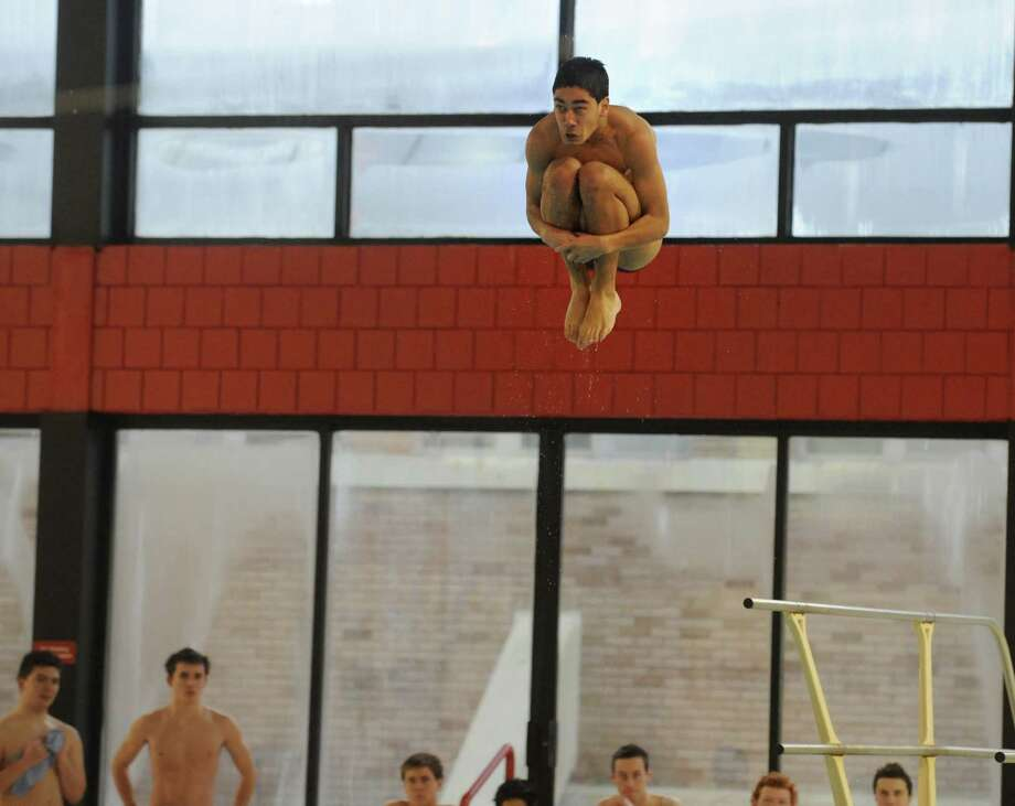 Fairfield Prep's Michael Connelly dives during their meet against Cheshire Tuesday, Jan. 28, 2014, at Fairfield University's Recreation Complex Pool. Photo: Autumn Driscoll / Connecticut Post