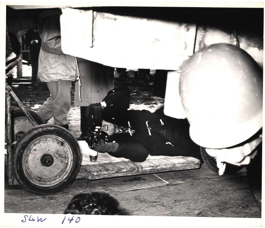 Stanley Kubrick  hangs under a trucks looks through a camera during the filming of 'Dr. Strangelove, Or How I Learned to Stop Worrying and Love the Bomb.' Photo: Weegee, Getty Images