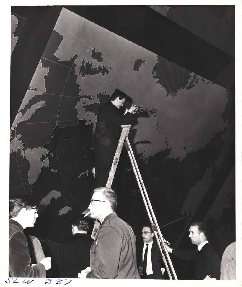 Stanley Kubrick stands atop a ladder on the 'War Room' set and looks through a camera during the filming of 'Dr. Strangelove, Or How I Learned to Stop Worrying and Love the Bomb.' Photo: Weegee, Getty Images
