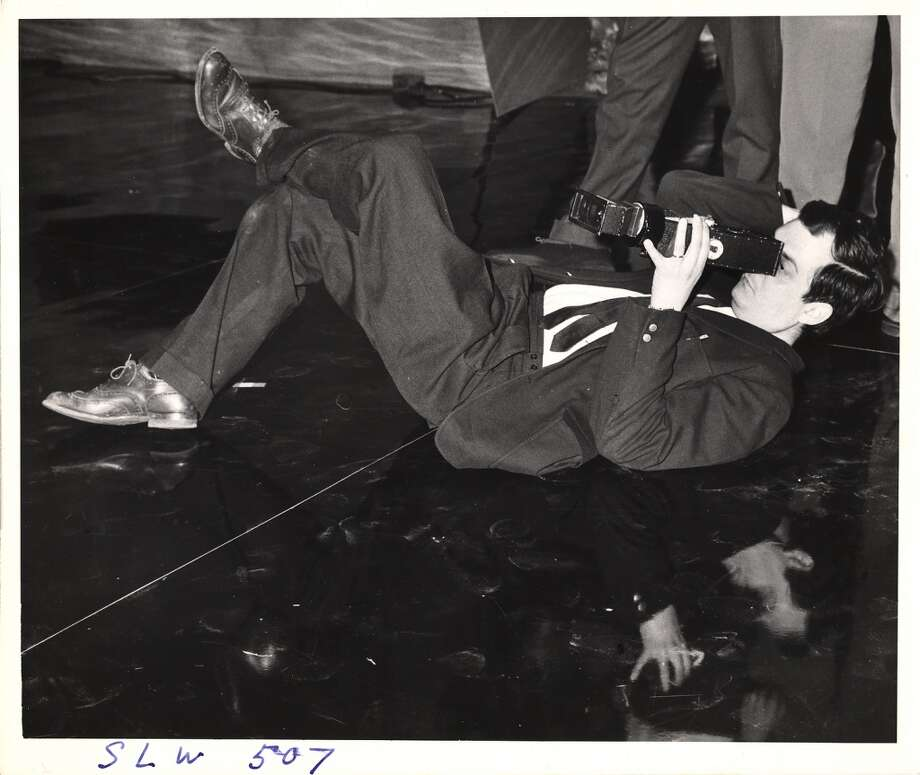 Stanley Kubrick lies on the floor of the 'War Room' set and looks through a camera during the filming of 'Dr. Strangelove, Or How I Learned to Stop Worrying and Love the Bomb.' Photo: Weegee, Getty Images