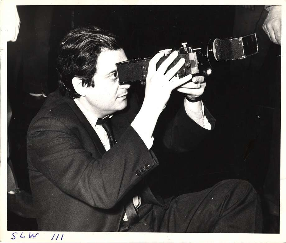 Stanley Kubrick looks through a camera during the filming of 'Dr. Strangelove.' Photo: Weegee, Getty Images
