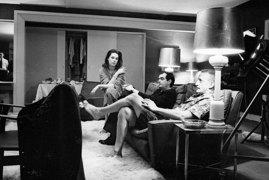 American film maker, Stanley Kubrick, on the set of his film 'Dr Strangelove or: How I Learned to Stop Worrying and Love the Bomb' with two of the actors, Tracy Reed and George C Scott, sitting on either side of him. Photo: Reg Lancaster, Getty Images