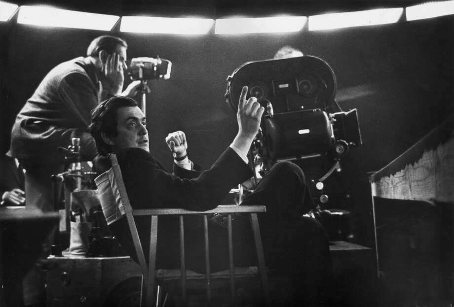 American film director Stanley Kubrick sits near a movie camera. Photo: Columbia Pictures, Getty Images
