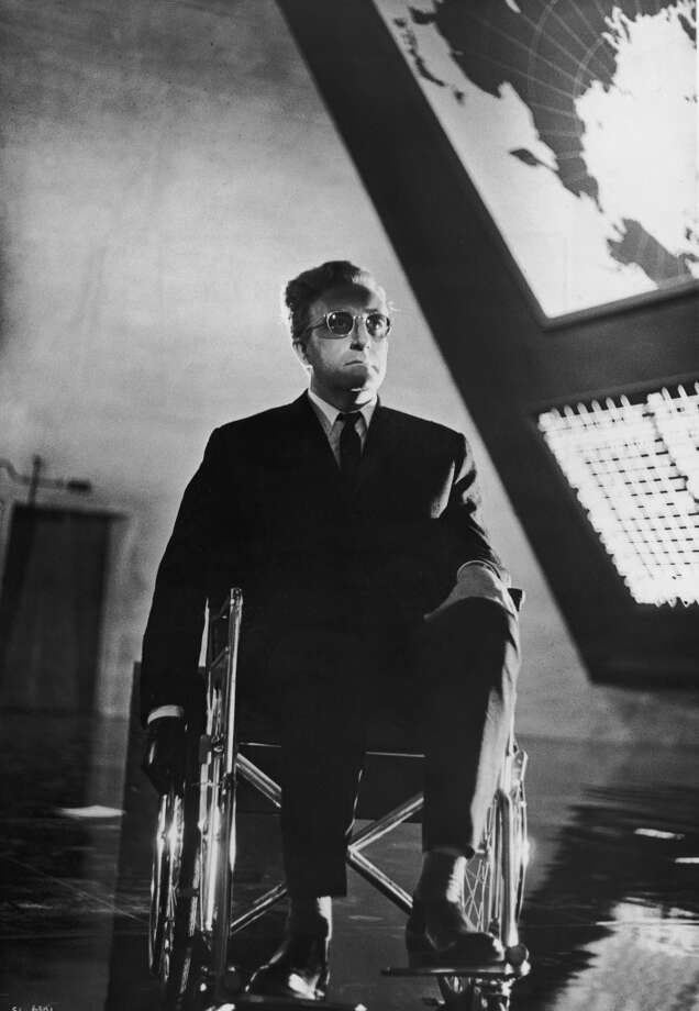 British actor Peter Sellers sits in a wheelchair in a still from director Stanley Kubrick's film, 'Dr. Strangelove or: How I Learned to Stop Worrying and Love the Bomb'. Photo: Hulton Archive, Getty Images