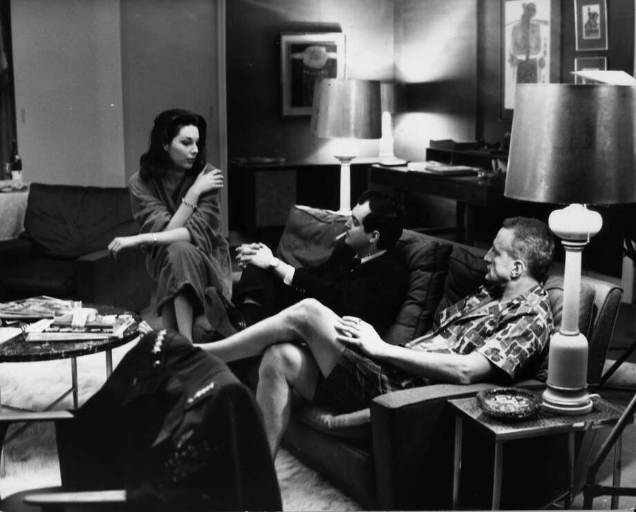 Actors Tracy Reed and George C Scott take time off the set of 'Dr Strangelove', being filmed at Shepperton Studios, for a discussion with director Stanley Kubrick. Photo: Keystone, Getty Images