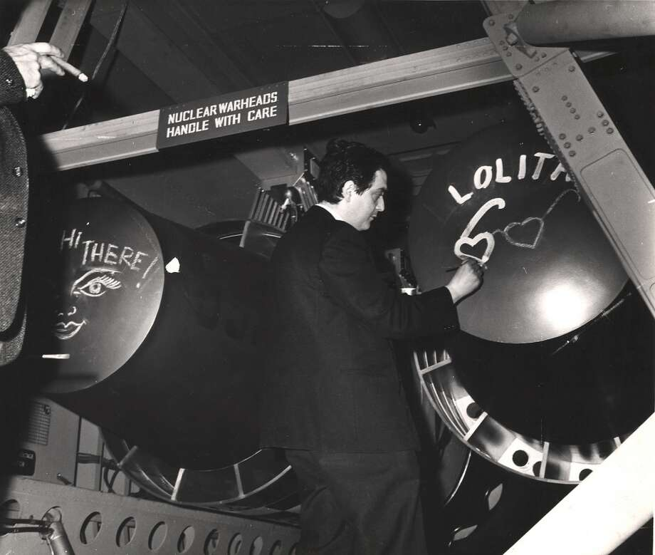 American film director Stanley Kubrick (1928 - 1999) draws a pair of heart-shaped sunglasses under the title 'Lolita' on the end of prop bomb while on the set of his film 'Dr. Strangelove, Or How I Learned to Stop Worrying and Love the Bomb' (1964), England, early 1963. 'Lolita,' based on the novel of the same name, was his previously completed film. Photo: Weegee(Arthur Fellig)/Internatio, Getty Images