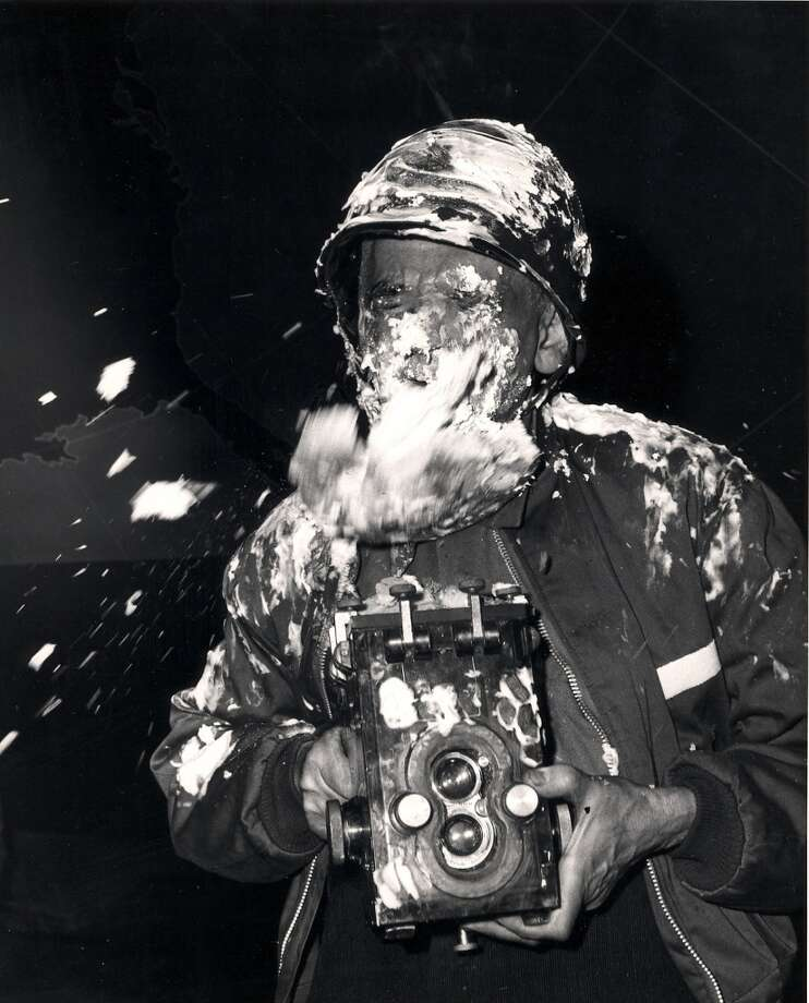 Polish-born American photographer Weegee (Arthur Fellig) (1899 - 1969), camera in hand, closes his eyes as a cream pie flies at him during filming on the set of the Stanley Kubrick film 'Dr. Strangelove, Or How I Learned to Stop Worrying and Love the Bomb' (1964), England, early 1963. Kubrick and the crew filmed a climactic pie fight in the War Room set to close the film, though it was cut before the fiolm ws released. Photo: Weegee(Arthur Fellig)/Internatio, Getty Images