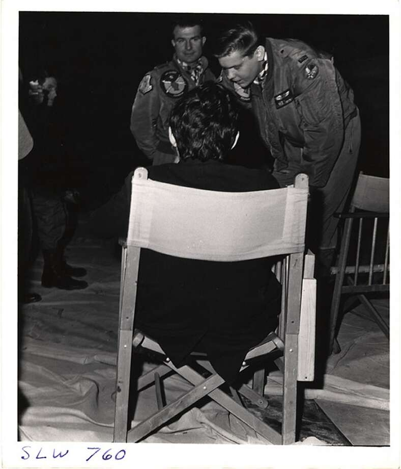 British film director Stanley Kubrick (1928 - 1999) (sitting fore) speaks with two, unidentified actors during the filming of his movie, 'Dr. Strangelove, Or How I Learned to Stop Worrying and Love the Bomb' at Shepperton Studios, Shepperton, England, 1963. Photo: Weegee(Arthur Fellig)/Internatio, Getty Images