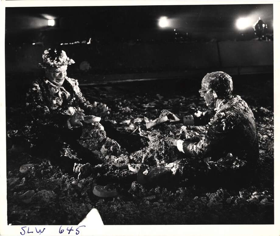 British actors Peter Bull (1912 - 1984) (as Alexi de Sadesky) (left) and Peter Sellers (1925 - 1980) (as President Merkin Muffley) sit on the floor, covered in cream pies, in the War Room set of the movie 'Dr. Strangelove, Or How I Learned to Stop Worrying and Love the Bomb' (directed by Stanley Kubrick) at Shepperton Studios, Shepperton, England, 1963. The sequence was eventually cut from the film before its release. Photo: Weegee(Arthur Fellig)/Internatio, Getty Images