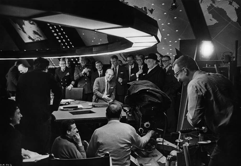 Stanley Kubrick (2nd from the left), and Peter Sellers (seated on the table) on the set of the film 'Dr. Strangelove: Or How I Came To Stop Worrying And Love The Bomb', 1964. Photo: Getty Images