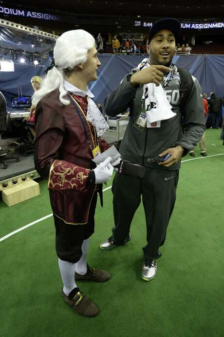 It's doubtful many of the players' musical tastes run in his direction, but that didn't stop Mozart, in the form of Austrian journalist Phillip Hajszan, from showing up at Super Bowl media day to interview players like the Seahawks'  K.J. Wright. Photo: TIMOTHY CLARY, Staff / AFP