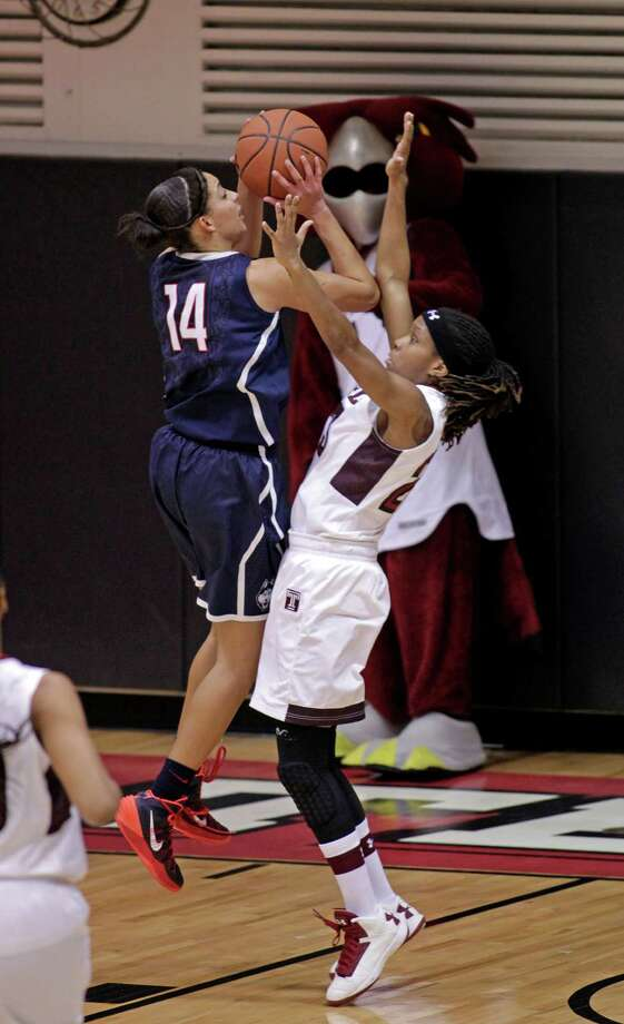 Connecticut's Bria Hartley (14) shoot over Temple's Tyonna Williams in the first half of an NCAA college basketball game, Tuesday, Jan. 28, 2014, in Philadelphia. (AP Photo/H. Rumph Jr.) Photo: H. Rumph Jr, Associated Press / Associated Press