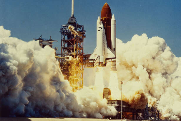 28th January 1986:  The space shuttle Challenger (STS-51L) takes off from the Kennedy Space Centre, Florida. 73 seconds later the shuttle exploded, killing its seven crew members.