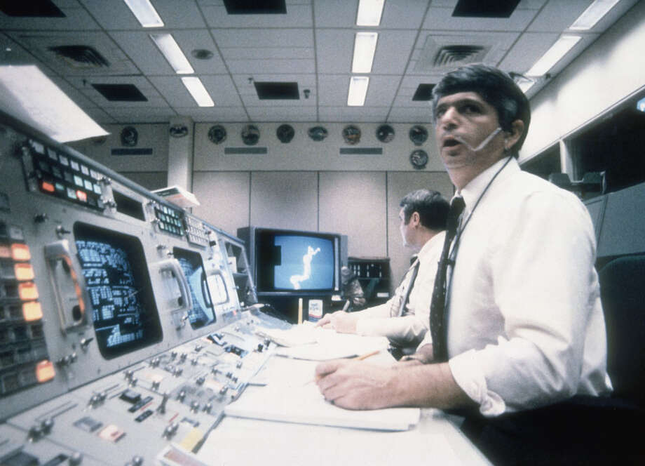 Flight Director Jay Greene (foreground) and Lee Briscoe, spacecraft communicators at Mission Control in Houston, watch helplessly as Space Shuttle Challenger explodes on takeoff on Jan. 28, 1986, killing all seven members of its crew. STS-51-L was Challenger's tenth launch and was scheduled to include the first Teacher in Space winner. Photo: Space Frontiers, Getty Images / 2004 Getty Images