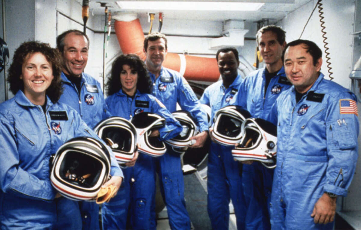 The crew of Challenger STS-51L crew after their TCDT (Terminal Countdown Demonstrations Test) on Jan. 8, 1986.