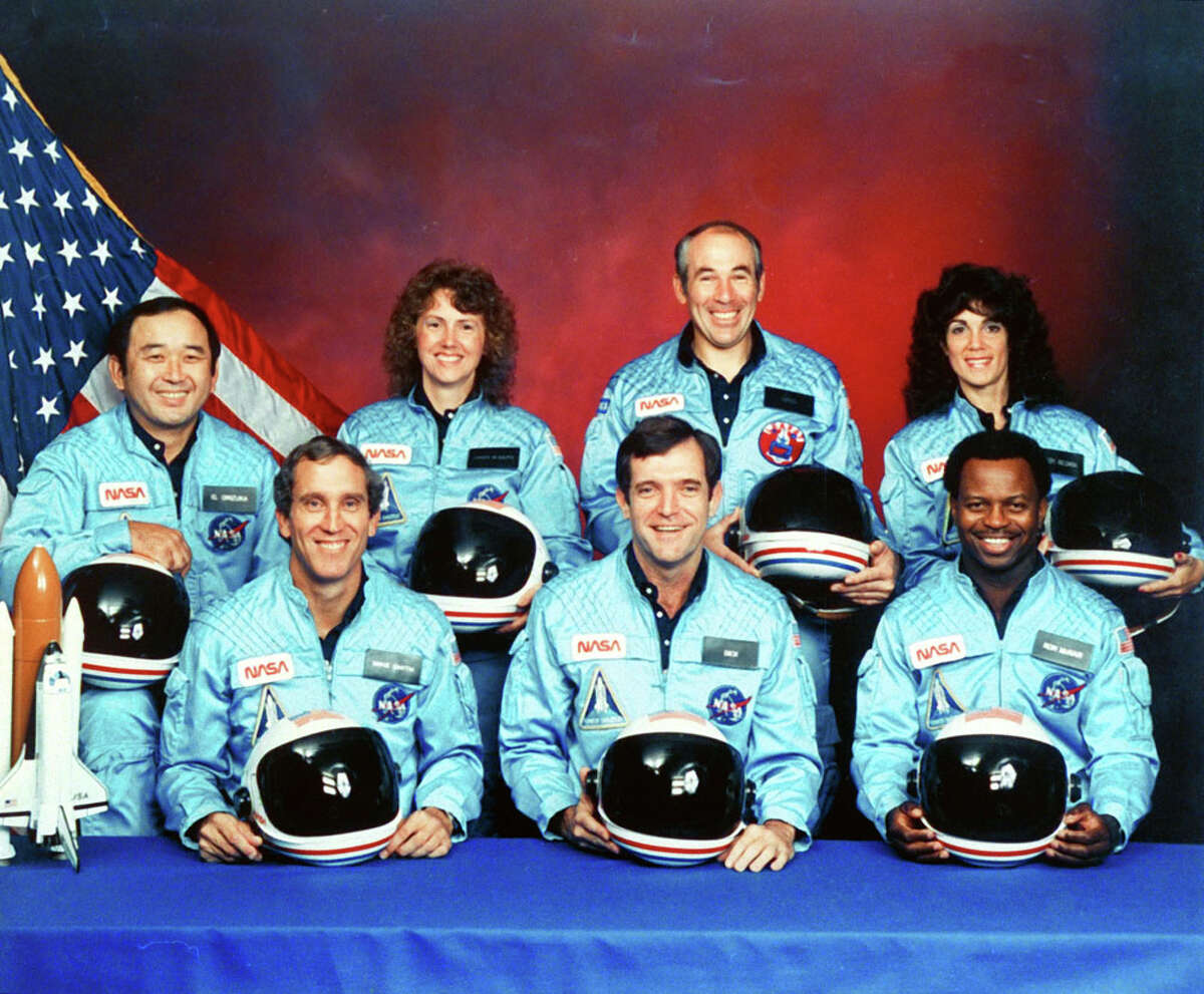 The crew of Space Shuttle Challenger X is seen in November 1985 at Johnson Space Center. Front row, from left: Michael J. Smith, Francis R. Scobee and Ronald E. McNair. Back row, from left: Ellison S. Onizuka, Christa McAuliffe, Gregory B. Jarvis and Judith A. Resnik.