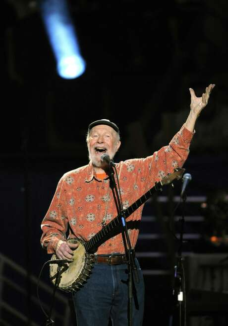 Pete Seeger performs during a concert marking his 90th birthday at Madison Square Garden in May 2009. His career was a mix of activism and optimism. Photo: TIMOTHY A. CLARY, Staff / AFP