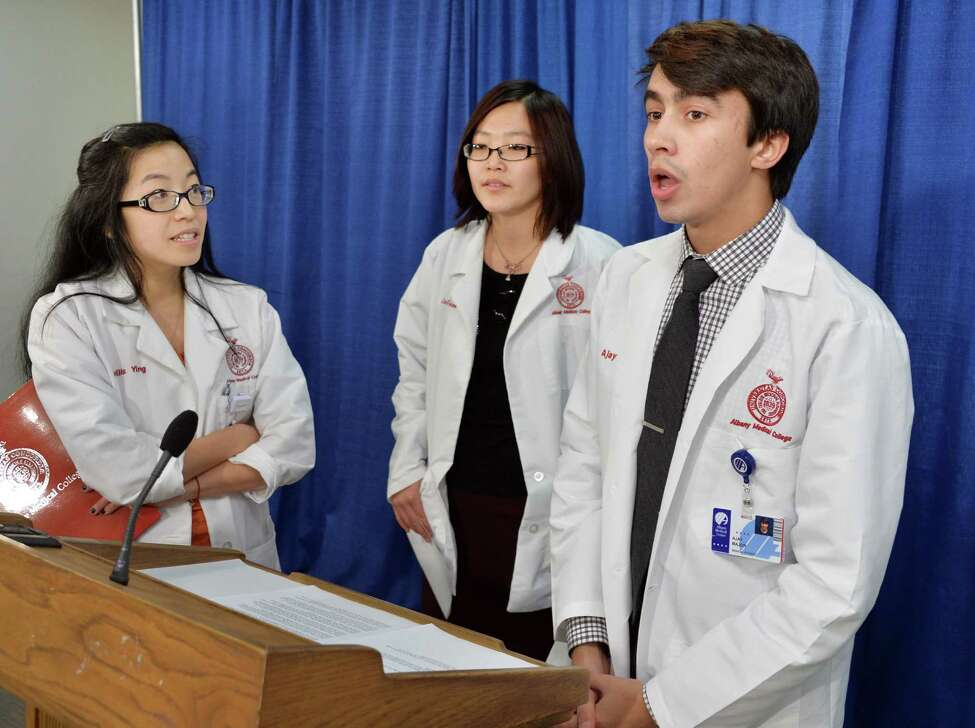 Albany Medical Center students, from left, Phyllis Ying, Xin Guan and Ajay Major speak during a news conference at the Legislative Office Building during Medical Student Advocacy Day at the Capitol Tuesday Jan. 28, 2014, in Albany, NY.(John Carl D'Annibale / Times Union)
