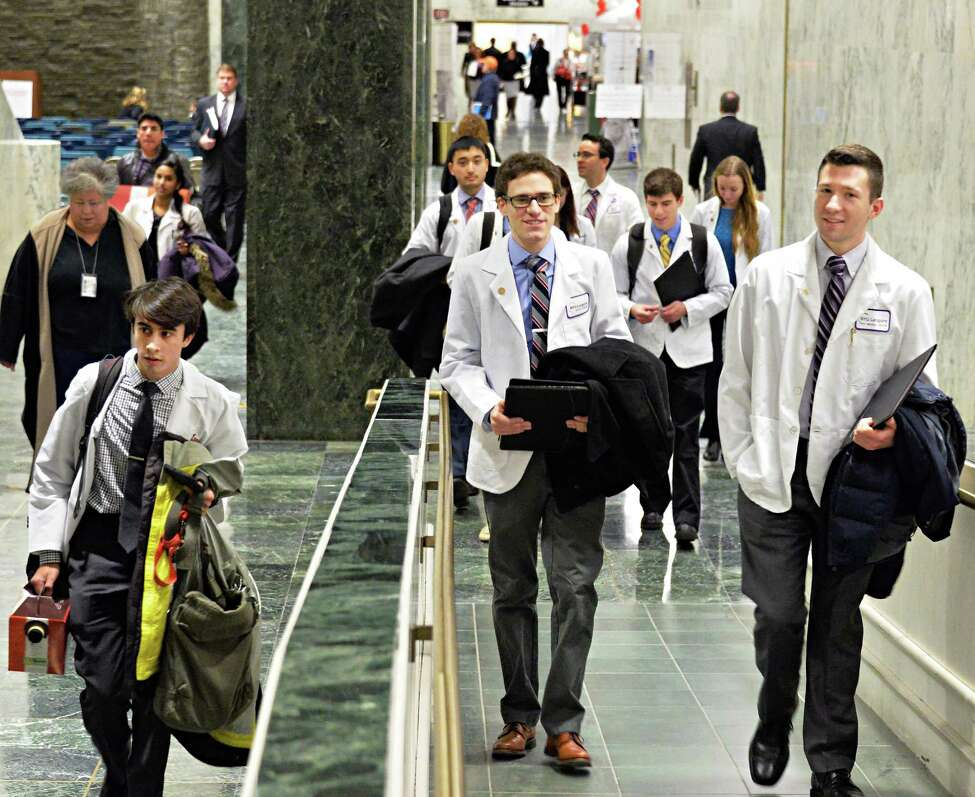 White-coated medical students crowed the halls of the Legislative Office Building during Medical Student Advocacy Day at the Capitol Tuesday Jan. 28, 2014, in Albany, NY.(John Carl D'Annibale / Times Union)