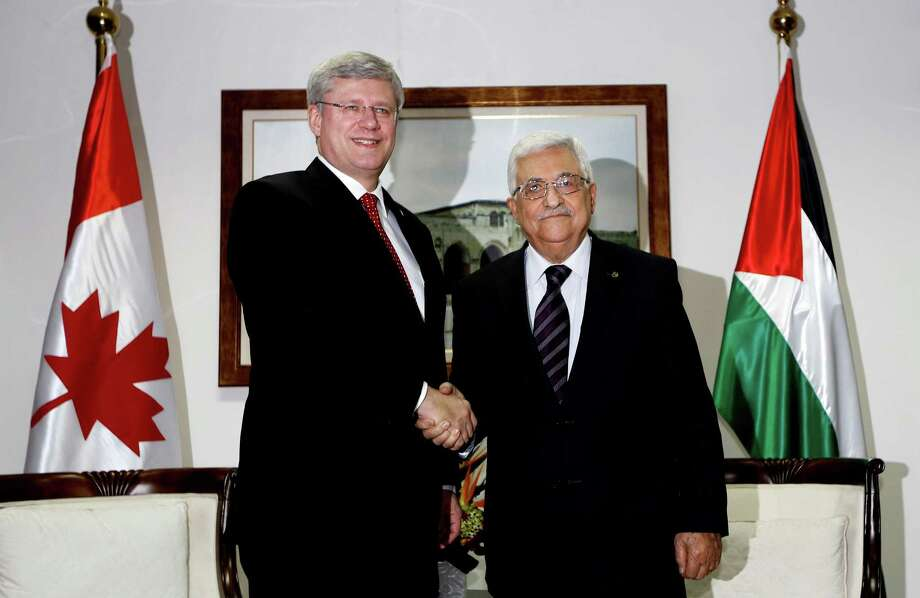 Palestinian President Mahmoud Abbas, right, shakes hands with Canadian Prime Minister Stephen Harper in the West Bank city of Ramallah, Monday, Jan. 20, 2014. (AP Photo/Mohamad Torokman, Pool) ORG XMIT: CAI102 Photo: Mohamad Torokman / Reuters Pool