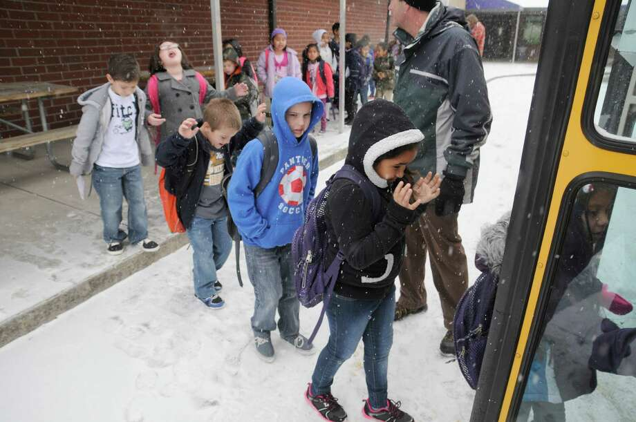 Sevierville Primary School students load up as school is let out early due to snow in Sevierville, Tenn., Tuesday, Jan. 28, 2014.  Snowfall across East Tennessee has led several school districts to call off classes early. (AP Photo/The Mountain Press, Curt Habraken) ORG XMIT: TNSEV102 Photo: Curt Habraken / The Mountain Press