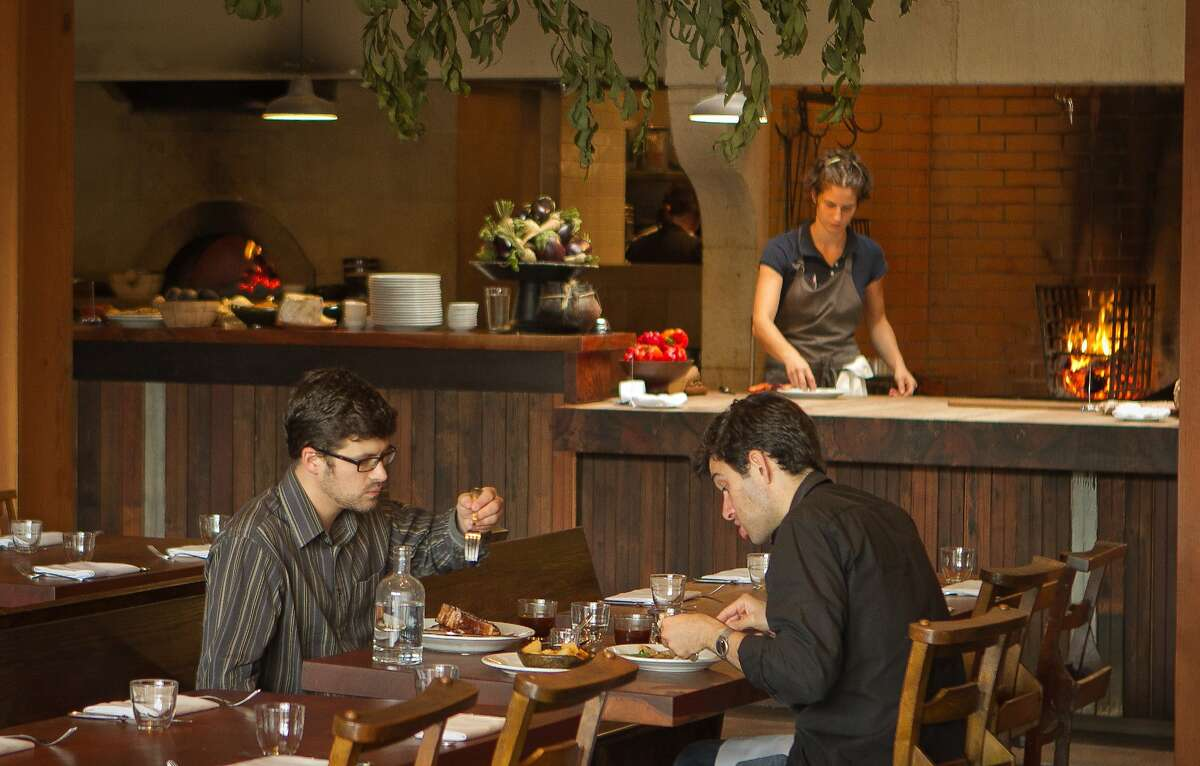 Diners enjoying brunch at Camino.