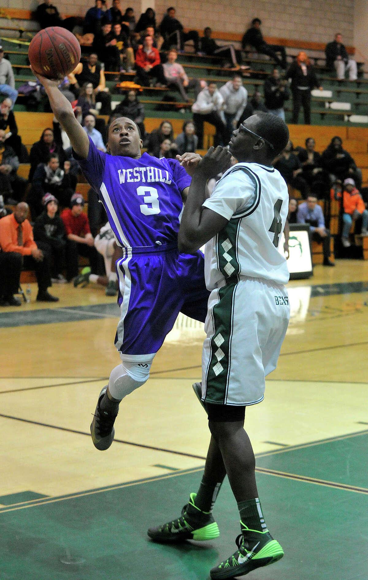 Westhill's C.J. Donaldson puts up a shot next to Norwalk's Roy Kane Jr during their basketball game at Norwalk High School in Norwalk, Conn., on Tuesday, Jan. 28, 2014. Westhill won, 68-56.