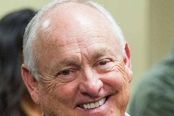 Texas Rangers executive Nolan Ryan smiles as he attends a press conference where his son Reid Ryan was introduced as the new Houston Astros president at Minute Maid Park on Friday, May 17, 2013, in Houston.   ( Smiley N. Pool / Houston Chronicle )