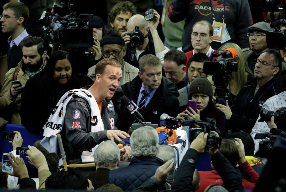 Denver Broncos' Peyton Manning answers questions during media day for the NFL Super Bowl XLVIII football game Tuesday, Jan. 28, 2014, in Newark, N.J. (AP Photo/Charlie Riedel)  ORG XMIT: SB128 Photo: Charlie Riedel / AP