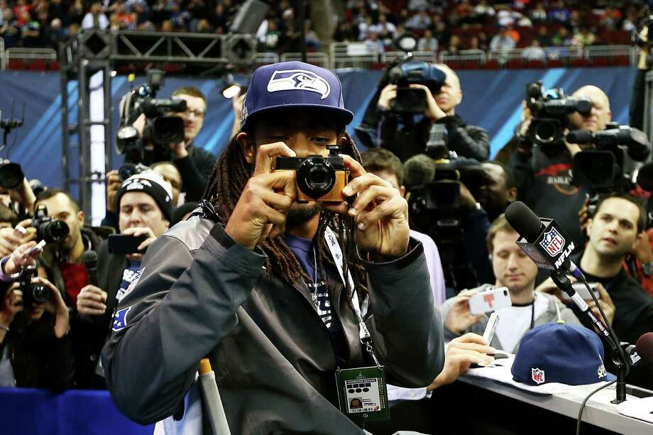 NEWARK, NJ - JANUARY 28:  Cornerback Richard Sherman #25 of the Seattle Seahawks takes a photo while talking to the media during Super Bowl XLVIII Media Day at the Prudential Center on January 28, 2014 in Newark, New Jersey.  Super Bowl XLVIII will be played between the Seattle Seahawks and the Denver Broncos on February 2.  (Photo by Elsa/Getty Images) ORG XMIT: 465298017 Photo: Elsa / 2014 Getty Images