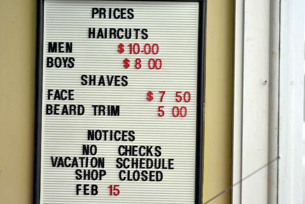 price board seen at Jim Monroes barber shop on Thursday, Jan. 23 ...