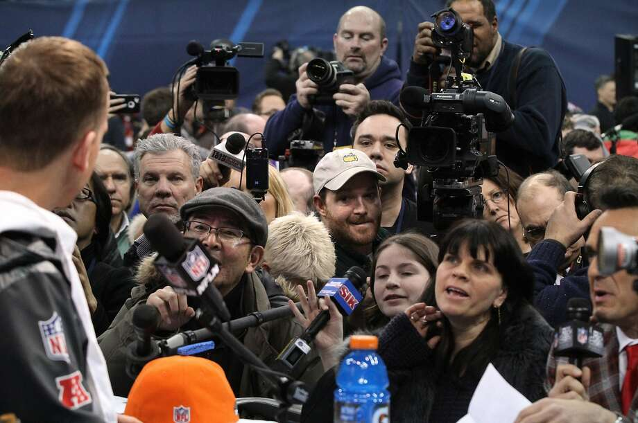 Peyton Manning faces some of the thousands covering Media Day in New Jersey. Photo: Tony Overman, McClatchy-Tribune News Service