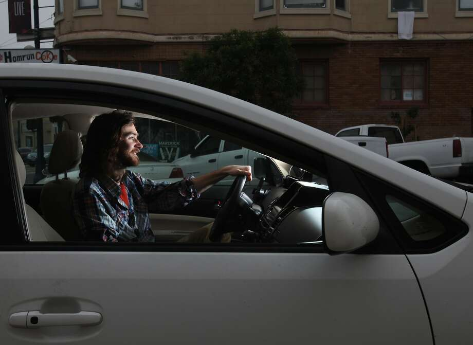 Andrew Holmgren uses his car, bought specifically for a gig with Lyft, to work 15 to 20 hours a week for the ride-sharing service. Photo: Leah Millis, The Chronicle