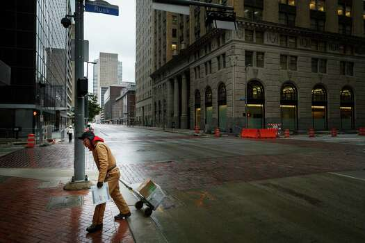 "John Parish delivers payroll packages Tuesday to businesses downtown on a cold wintery day that blasted through Houston. ""The weather could be worse,"" Parish said.  ""We could be living in Michigan."" Photo: Michael Paulsen, Staff / © 2014 Houston Chronicle"