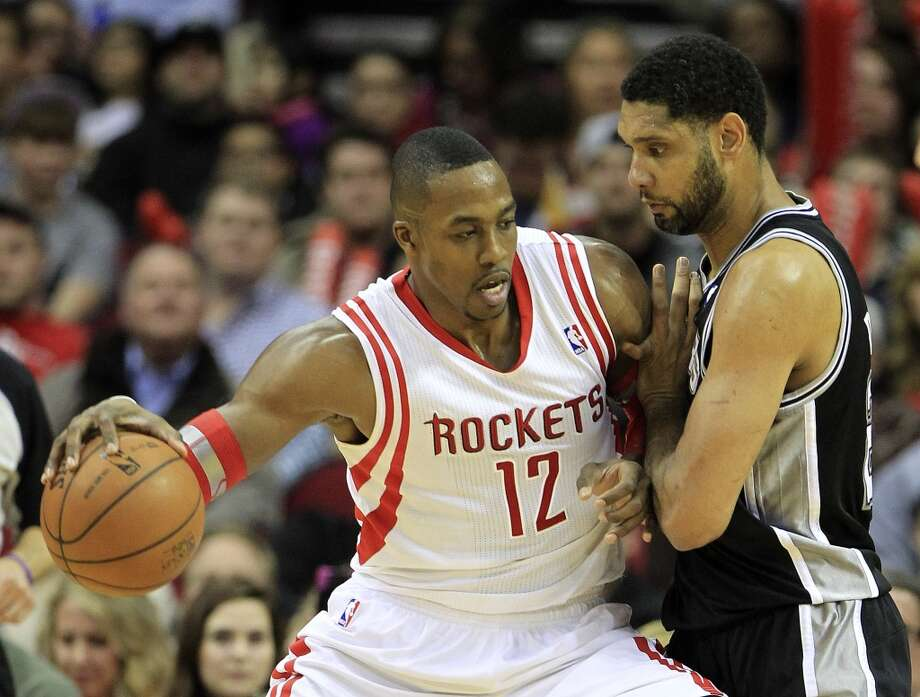 Jan. 28: Rockets 97, Spurs 90  Rockets center Dwight Howard backs down Tim Duncan of the Spurs. Photo: Karen Warren, Houston Chronicle