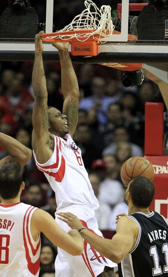 Rockets forward Terrence Jones gets a dunk against the Spurs. Photo: Karen Warren, Houston Chronicle