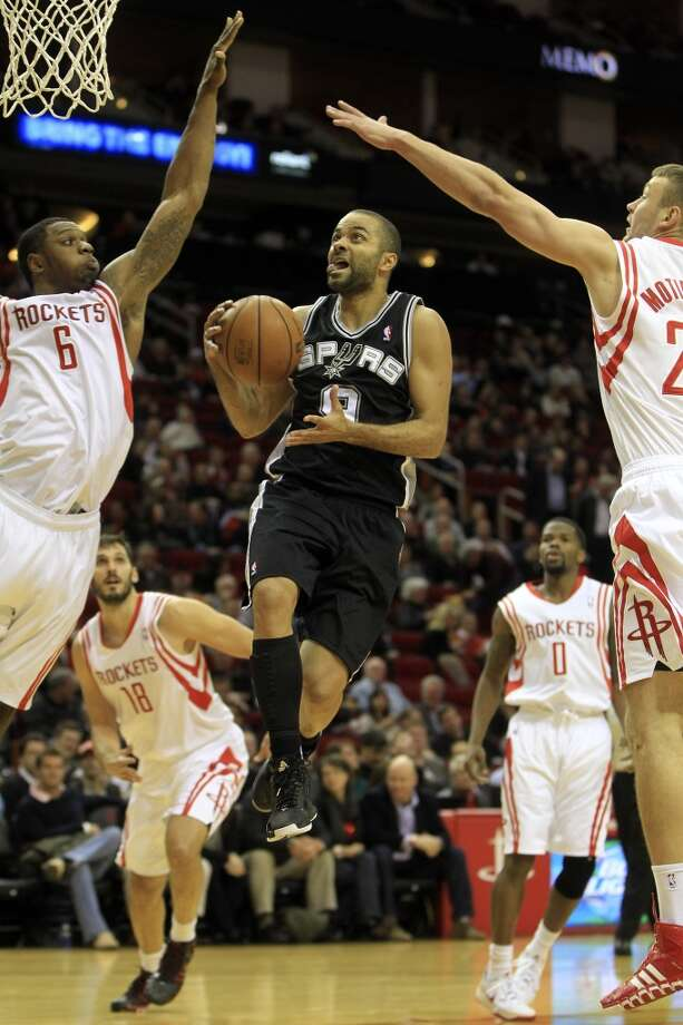 Spurs point guard Tony Parker drives against the Rockets. Photo: Karen Warren, Houston Chronicle